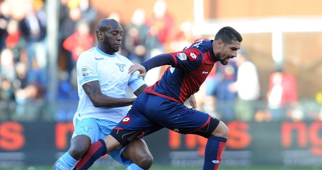 Marco Borriello moves away from Michael Ciani.