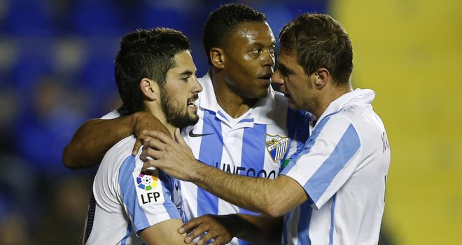 Isco (l) celebrates with his Malaga team-mates