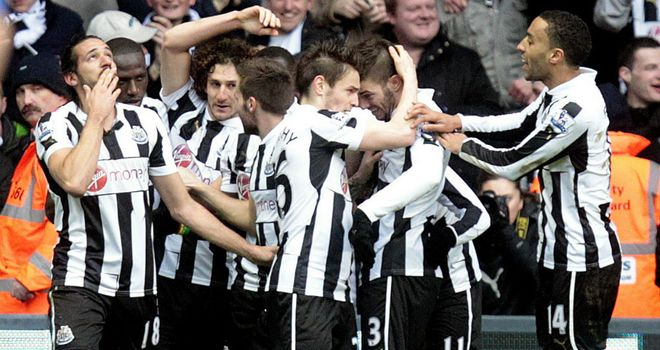 Newcastle players celebrate against Chelsea