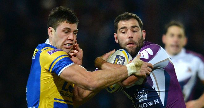 Joel Moon tangles with Melbourne's Cameron Smith