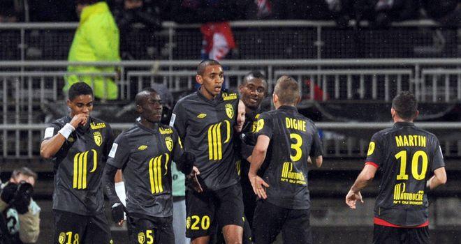 Lille celebrate Florent Balmont's goal.