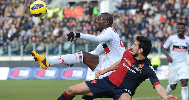 Mario Balotelli tries to get the ball down
