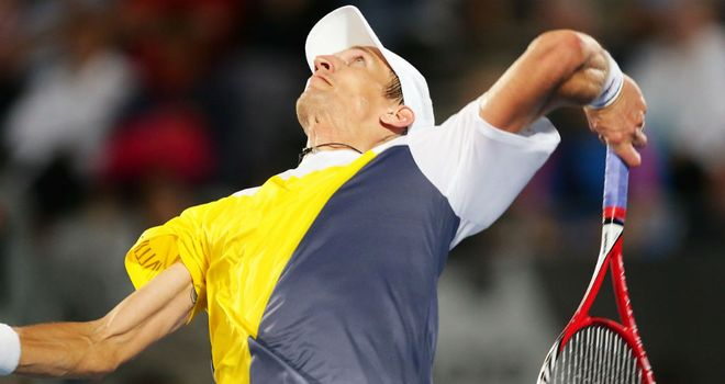 Jarkko Nieminen: held his nerve in a second-set tie-break to defeat his Russian opponent