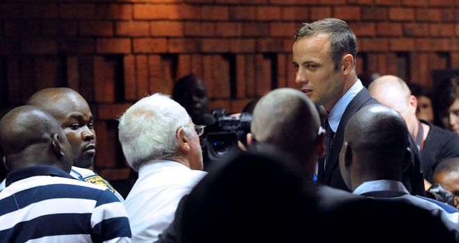 Oscar Pistorius: Back in court on Tuesday for the first time since he broke down at an initial hearing on Friday (above).