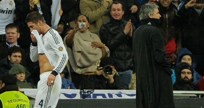 Sergio Ramos passes coach Jose Mourinho after being sent off