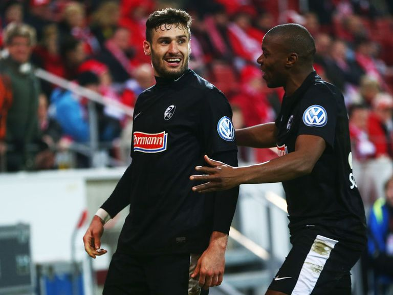 Daniel Caligiuri celebrates scoring for Freiburg