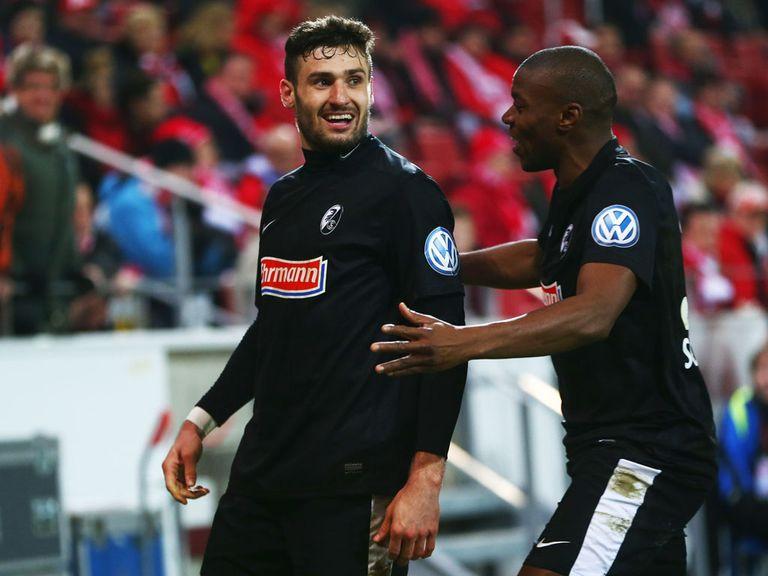 Daniel Caligiuri celebrates scoring for Freiburg