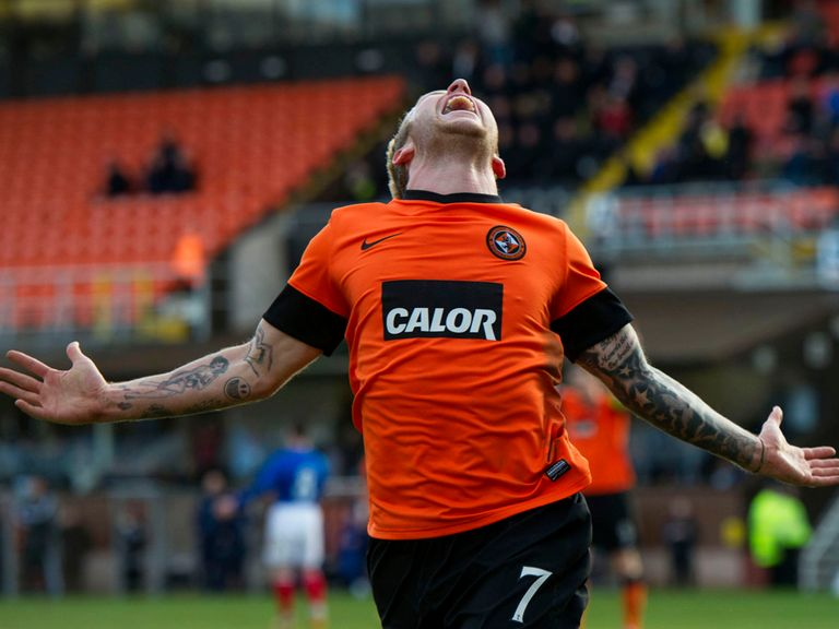 Johnny Russell celebrates as Dundee United beat Rangers.