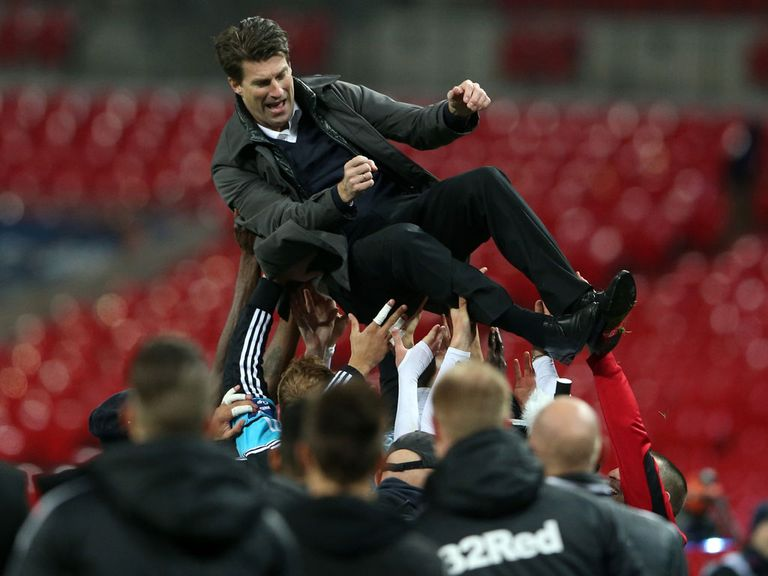Swansea boss Michael Laudrup celebrates at Wembley.