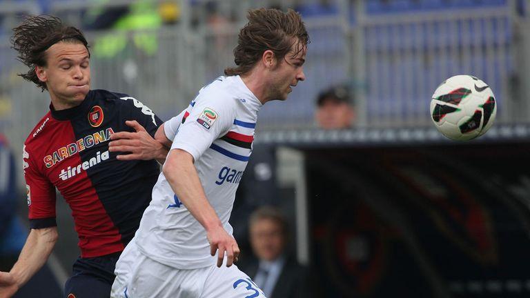 Albin Ekdal puts Tommaso Berni under pressure.
