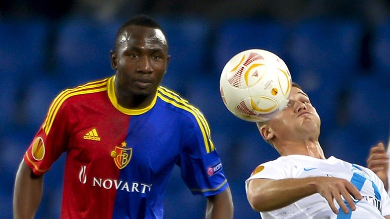 Jacques Zoua and Igor Denisov battle for the ball