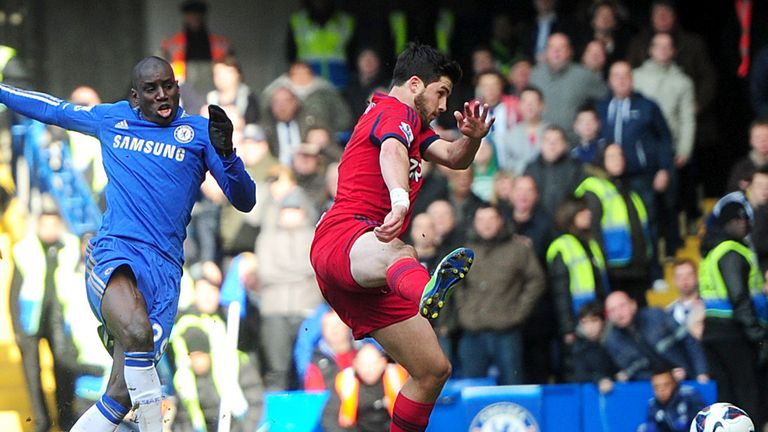 Demba Ba slots home the opening goal for Chelsea