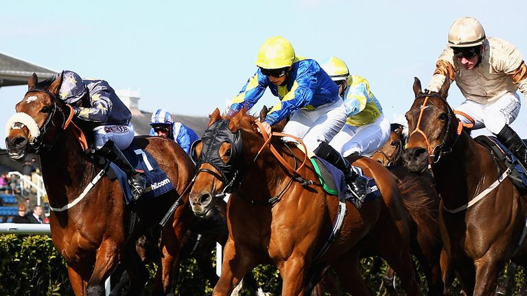 Levitate (in blue) winning the Lincoln on soft ground