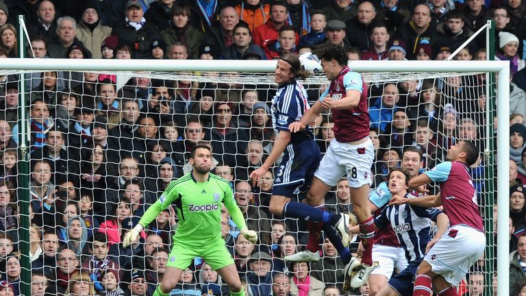 Andy Carroll scores the first of his two goals against West Brom