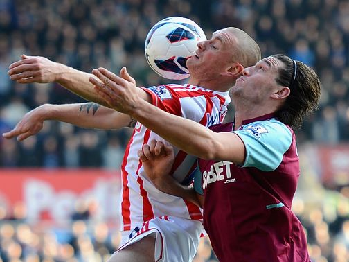 Andy Wilkinson holds off Andy Carroll