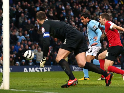 Carlos Tevez breaks the deadlock from close range