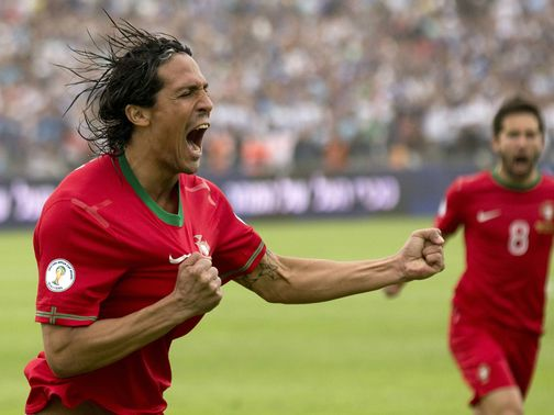 Bruno Alves celebrates scoring the opening goal