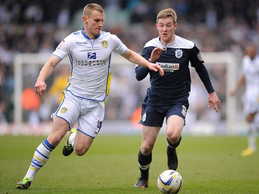 Tom Lees and Paul Dixon battle for the ball