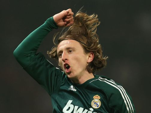 Modric celebrates his goal at Old Trafford