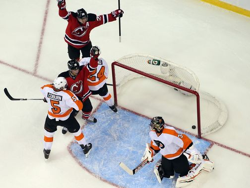 The Devils celebrate a Henrique goal