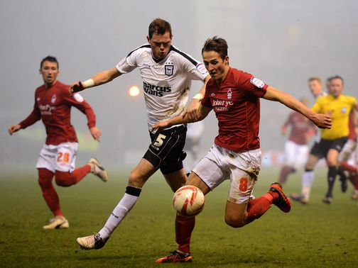 Richard Stearman and Chris Cohen battle for the ball