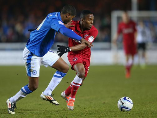Mark Little and Callum Harriott battle for the ball