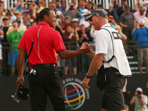 Tiger Woods is congratulated by Joe LaCava