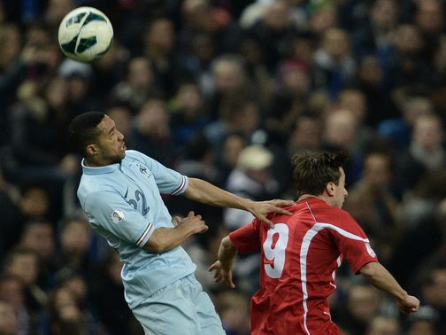 Gael Clichy wins a header.