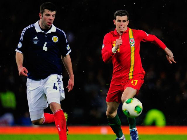 Grant Hanley and Gareth Bale chase the ball.