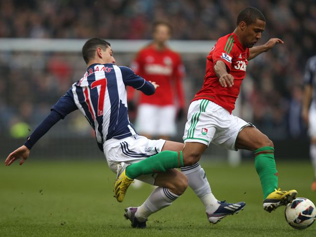Graham Dorrans challenges Wayne Routledge