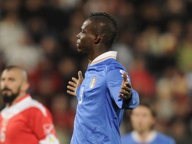 Mario Balotelli celebrates for Italy