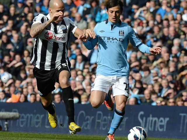 Gabriel Obertan vies for the ball with David Silva