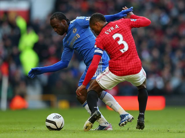 Victor Moses tangles with Patrice Evra.