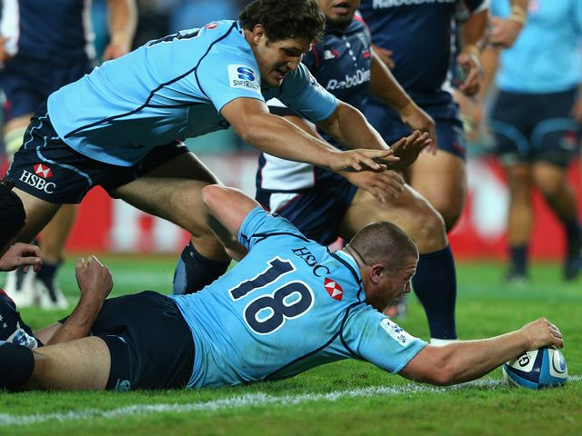 Paddy Ryan goes in for a Waratahs try