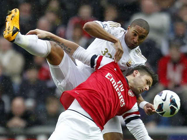 Olivier Giroud vies with Swansea's Ashley Williams
