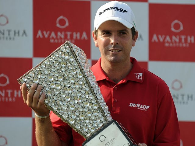 Aiken poses with the Avantha Masters trophy