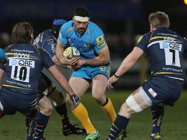 Andrea Masi looks for a way through the Worcester defence