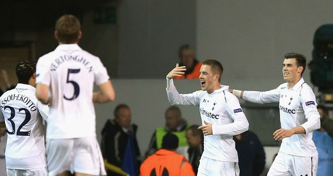 Tottenham: Celebrate Gylfi Sigurdsson's goal on their way to a 3-0 win over Inter Milan