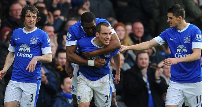 Everton celebrate Leon Osman's opener against Manchester City
