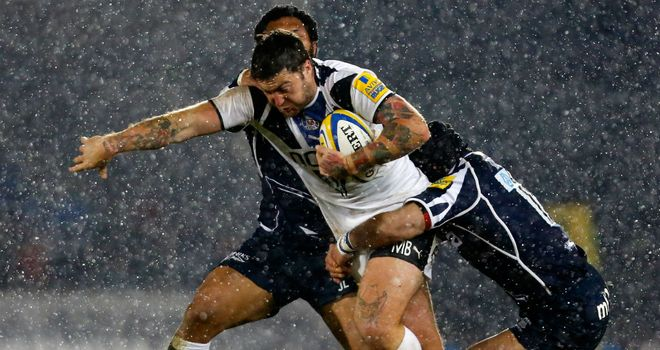 Matt Banahan is brought down by two Sale tacklers