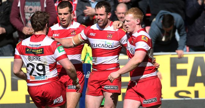 Pat Richards is congratulated by his team mates after scoring his second try of the match