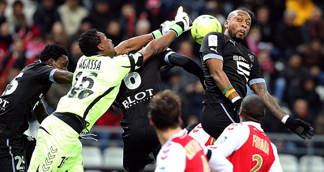 Reims keeper Kossi Agassa punches clear