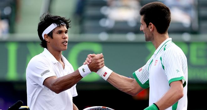 Novak Djokovic (right) shakes hands with Somdev Dewarman