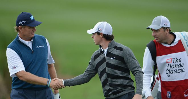Rory McIlroy shakes hands with Ernie Els before quitting the Honda Classic