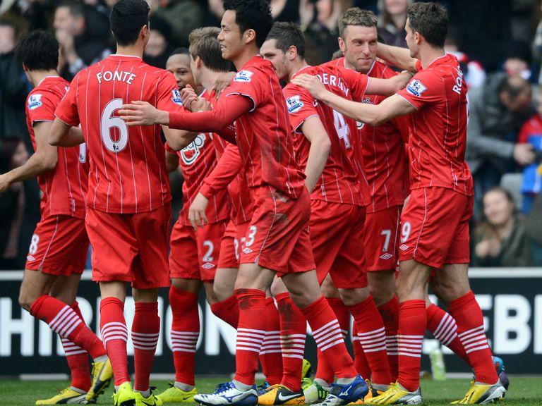 Lambert: Celebrates with team-mates