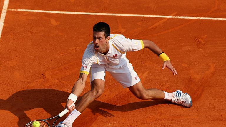Novak Djokovic: Serb digs out a forehand during third-round win in Monte Carlo