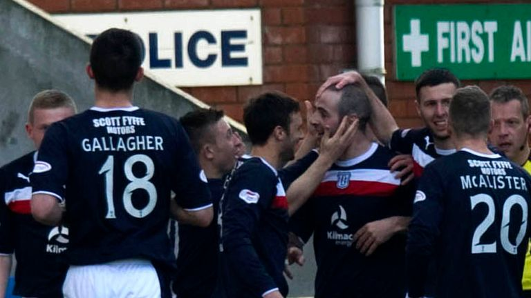 Gary Harkins: Congratulated by his Dundee team-mates