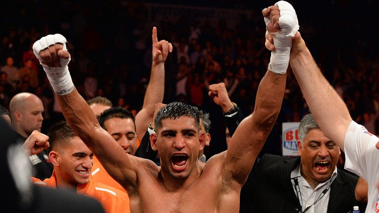 Khan celebrates a points decision which is thought to have put him in a position to challenge for titles