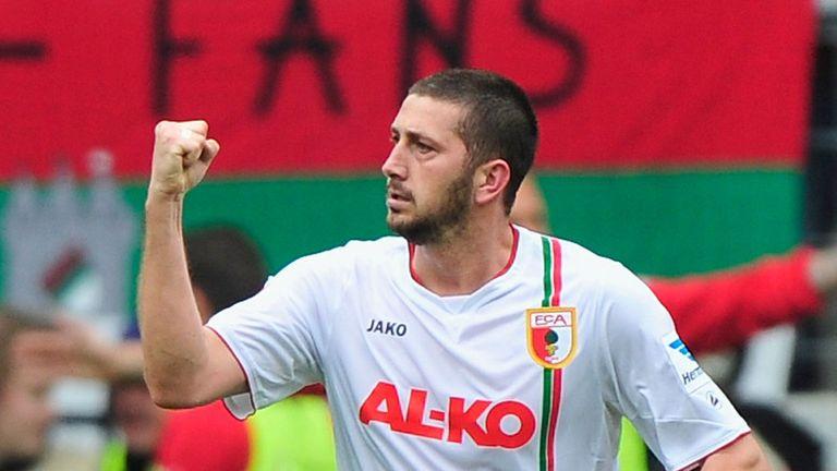 Sascha Moelders celebrates his goal for Augsburg