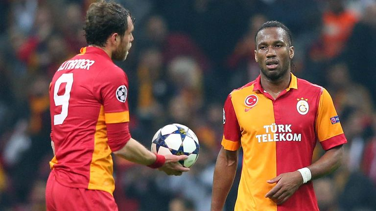 Johan Elmander hands the ball to Didier Drogba, one of Galatasaray's scorers in their heroic defeat